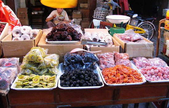 a street vendor selling preserved fruits