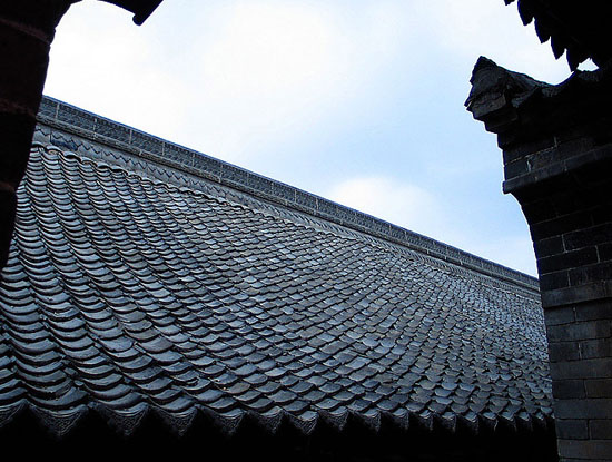 the tiles covered roof of the old house